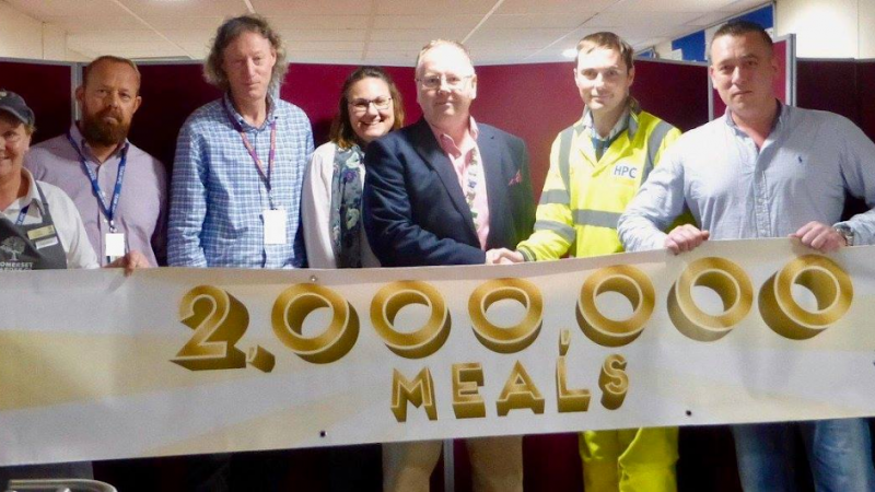 People Holding Banner 200,000 Meals