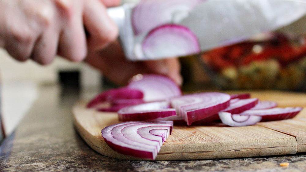 Chopping onions on chopping board
