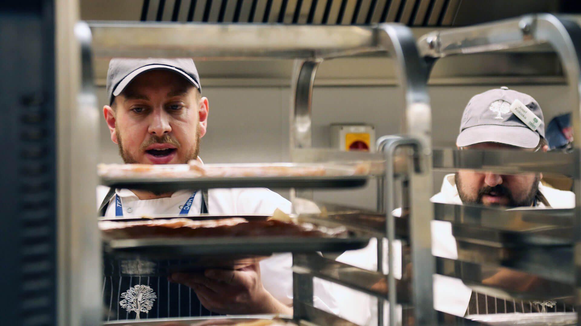 Chefs working in kitchen